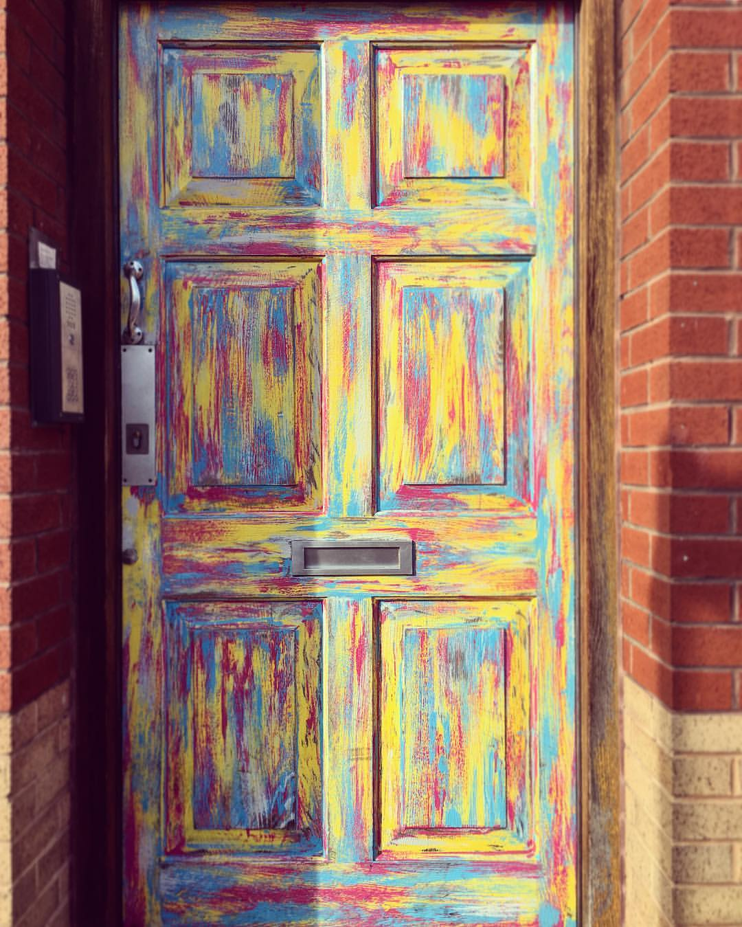 Colourful door of Redbrick House, Stokes Croft, Bristol